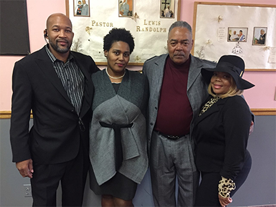 Edward Nelson (gray jacket) with his children (from left to right, Nakia Darrough, Roxie Nelson and Jacquetta Stephen)